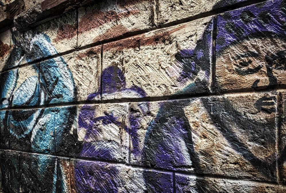 REUTERS — Too good to be true? Slum graffiti warns Kenyans about trafficking risks
